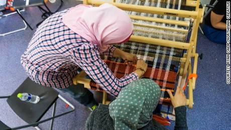 Women weave a welcome mat at the Ritsona Refugee Camp in Greece for the Welcome Project