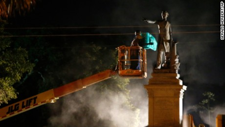 Workers prepare to take down the Jefferson Davis statue Thursday in New Orleans.