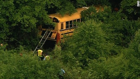 A school bus veers off I-44 near St. Louis on Thursday to avoid a careening car, officials say.