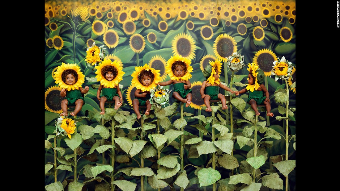 "Children are posed as sunflowers in this 1998 photo by Anne Geddes. In her newest book, <a href=""https://www.taschen.com/pages/en/catalogue/photography/all/05305/facts.anne_geddes_small_world.htm"" target=""_blank"">""Small World,""</a> Geddes reflects on a career that has spanned three decades. There are many photos in the book that have never been published before."