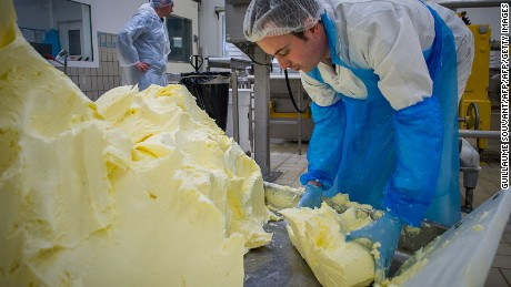 A worker takes butter in a manufacture in Echire on March 17, 2015. This unique process at the dairy Echire can produce up to 900 kilos of butter by wooden churn. PHOTO AFP/GUILLAUME SOUVANT        (Photo credit should read GUILLAUME SOUVANT/AFP/Getty Images)