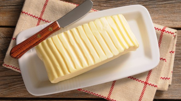 """The third most damaging food, by some distance, is butter: one kilo of butter equals nearly 12 kilos of CO2 -- about half as many as beef. It belongs to the same supply chain, making dairy and beef cattle an environmentalist's nightmare.  While Americans have greatly reduced their consumption of red meat in recent years, the NRDC reports that butter and other dairy products such as cheese and yogurt actually enjoyed a surge in the observed period, from 2005 to 2014.  Butter is the most climate damaging of all dairy products because there are several steps involved in producing it that are energy-intensive: """"For example, butter production requires separating raw milk into low-fat milk and cream, pasteurizing the cream, cooling the cream, ripening and churning,"""" Sujatha Bergen told CNN."""