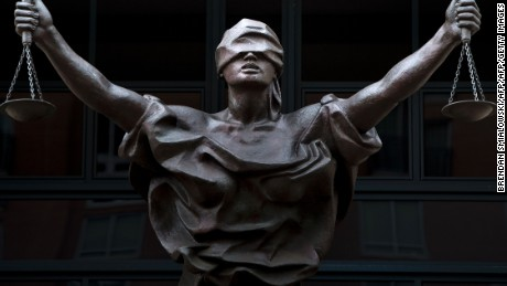 A statue of Justice is seen outside as a sentencing hearing takes place for Marcel Lehel Lazar, a hacker known as Guccifer, at the Albert V. Bryan US federal courthouse September 1, 2016 in Alexandria, Virginia. Lazar earlier pleaded guilty to unauthorized access to a protected computer and aggravated identity theft. 'Guccifer' allegedly published correspondence that led to the discovery of former US Secretary of State Hillary Clinton's private email server system. / AFP / Brendan Smialowski        (Photo credit should read BRENDAN SMIALOWSKI/AFP/Getty Images)