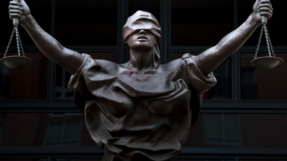 A statue of Justice is seen outside as a sentencing hearing takes place for Marcel Lehel Lazar, a hacker known as Guccifer, at the Albert V. Bryan US federal courthouse September 1, 2016 in Alexandria, Virginia. Lazar earlier pleaded guilty to unauthorized access to a protected computer and aggravated identity theft.
