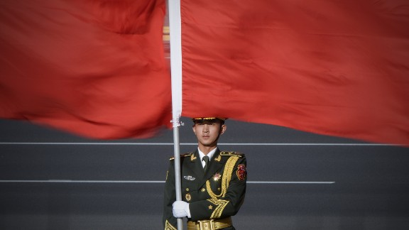 A Chinese honour guard holds the national flag at the Great Hall of the People in Beijing.