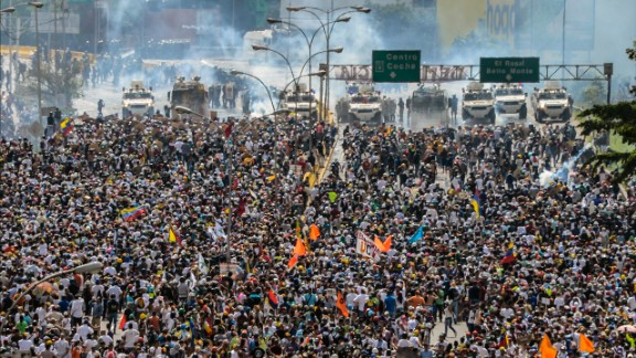 Thousands of Venezuelan protesters march on a Caracas highway on Wednesday, May 10.