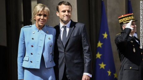 Emmanuel Macron poses with his wife, Brigitte Trogneux, at the presidential palace Sunday