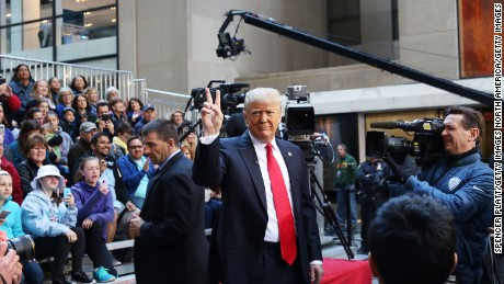 NEW YORK, NY - APRIL 21:  Republican presidential candidate Donald Trump waves while appearing at an NBC Town Hall at the Today Show on April 21, 2016 in New York City.  The GOP front runner appeared with his wife and family and took questions from audience members.  (Photo by Spencer Platt/Getty Images)