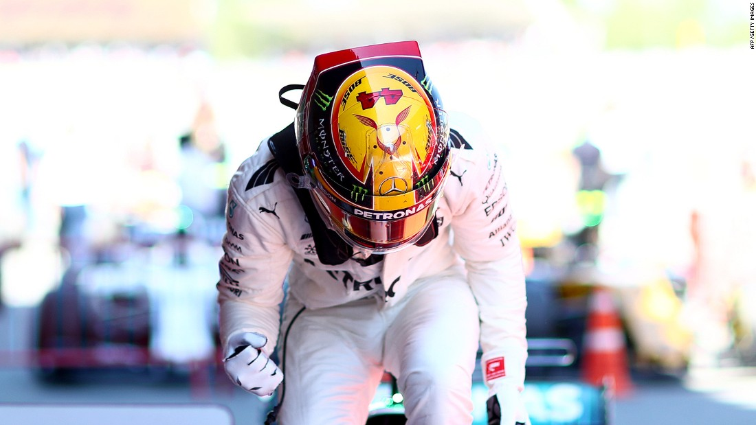 Race winner: Lewis Hamilton celebrates in parc ferme after taking the checkered flag at Sunday's Spanish Grand Prix.