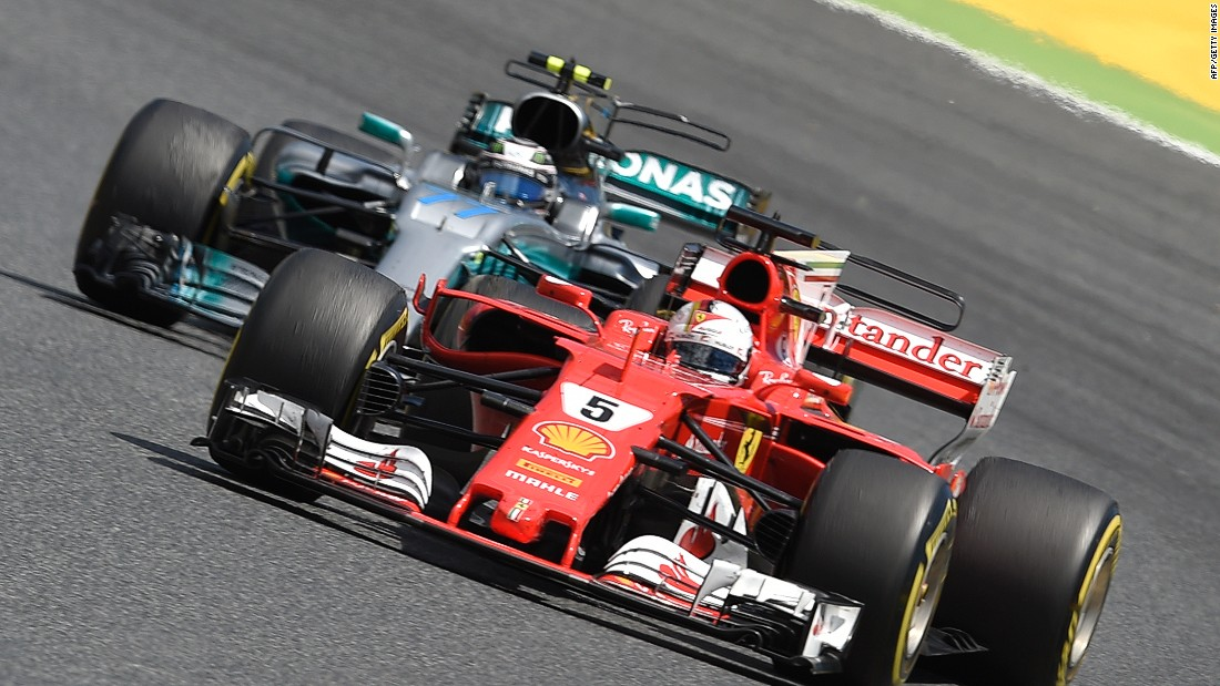 Vettel and Hamilton's teammate Valtteri Bottas vie for track position during Sunday's grand prix in Barcelona. Bottas, winner in Russia, eventually retired from the race with an engine failure.