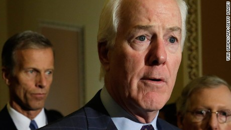 Senator John Cornyn(C) (R-TX) speaks to the media as Senate Majority Leader Mitch McConnell(R) ,R-KY, and John Thune(2nd-L), R-SD, and John Barrasso ,R-PA, look on after a policy luncheon on Capitol Hill in Washington, DC on September 27, 2016. / AFP / YURI GRIPAS        (Photo credit should read YURI GRIPAS/AFP/Getty Images)