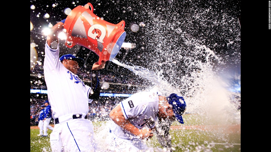 Salvador Perez dumps water onto Kansas City teammate Brandon Moss after the Royals defeated Baltimore 3-2 on Friday, May 12.