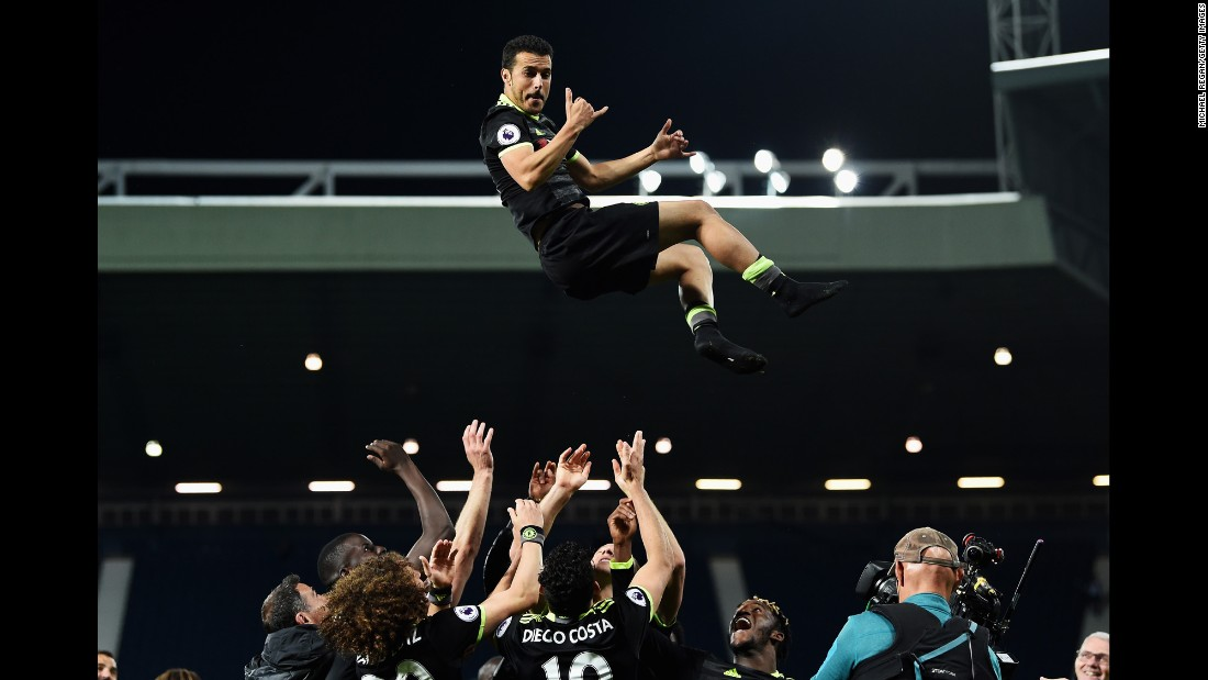 "Chelsea players throw Pedro into the air after their victory at West Brom <a href=""http://www.cnn.com/2017/05/12/football/antonio-conte-chelsea-premier-league-title-winners-west-brom-batshuayi/index.html"" target=""_blank"">clinched the Premier League title</a> on Friday, May 12. It was the London club's second league title in three years."