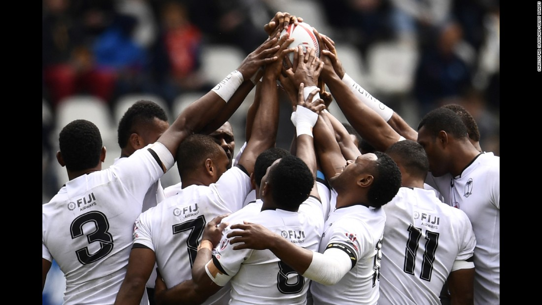 Fiji's rugby sevens team prays before a match in Paris on Sunday, May 14.
