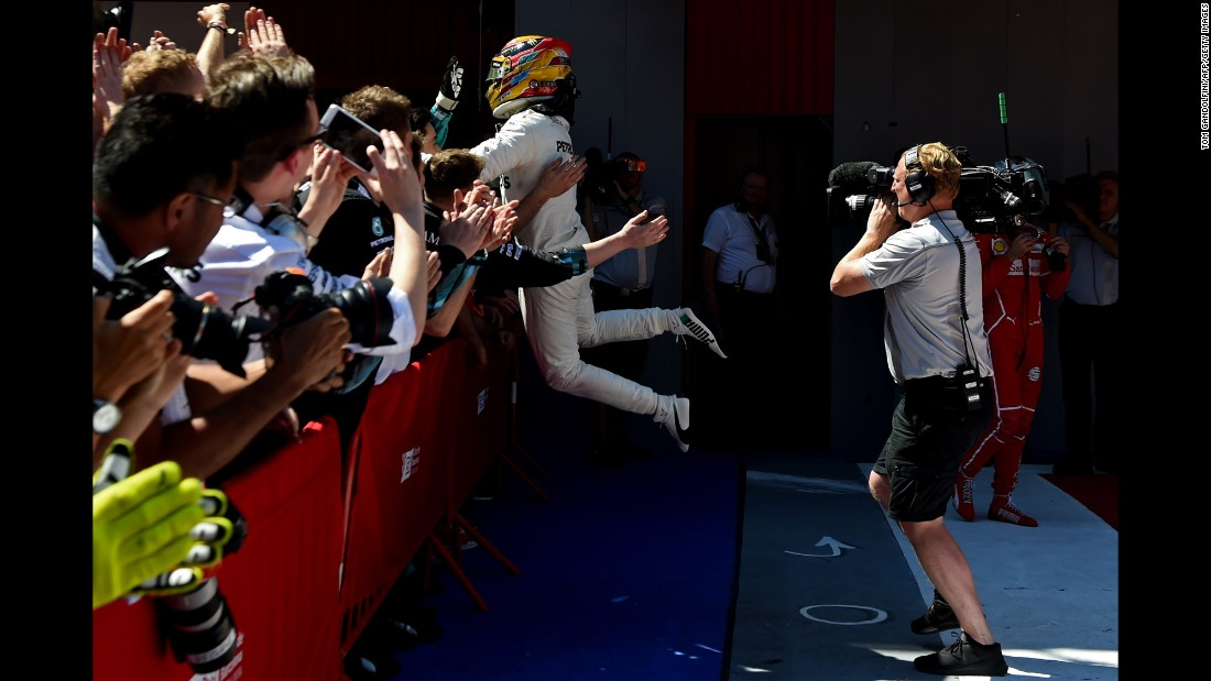 "Formula One driver Lewis Hamilton celebrates with team members after <a href=""http://www.cnn.com/2017/05/14/motorsport/spanish-grand-prix-hamilton-vettel/index.html"" target=""_blank"">winning the Spanish Grand Prix</a> on Sunday, May 14. <a href=""http://www.cnn.com/2017/05/09/sport/gallery/what-a-shot-sports-0509/index.html"" target=""_blank"">See 29 amazing sports photos from last week</a>"