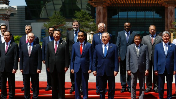 Russian President Vladimir Putin, Chinese President Xi Jinping and other world leaders pose for a group photo at the Belt and Road Forum in Beijing.