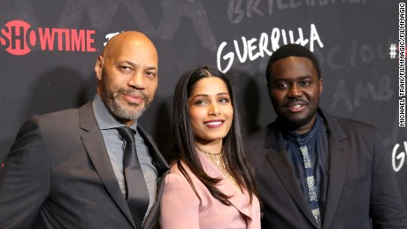 """Guerrilla"" executive producer John Ridley with stars Freida Pinto and Babou Ceesay."