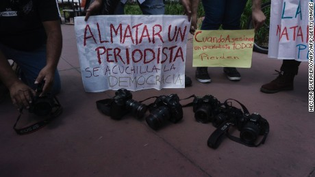 Journalists hold signs against violence to journalists in Mexico during a protest against the recent murder of the correspondent journalist Miroslava Breach, of La Jornada newspaper, in Guadalajara on March 26, 2017.  Breach, who investigated drug gangs, was found murdered earlier this week in Chihuahua, northern Mexico near the US border, with multiple gunshot wounds to the head. / AFP PHOTO / Hector Guerrero        (Photo credit should read HECTOR GUERRERO/AFP/Getty Images)