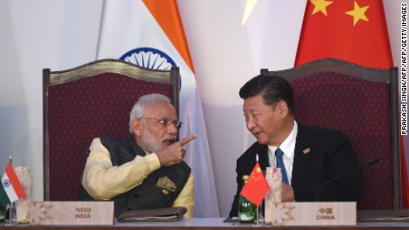 India Prime Minister Narendra Modi gestures while talking with China's President Xi Jinping in Goa on October 16, 2016.