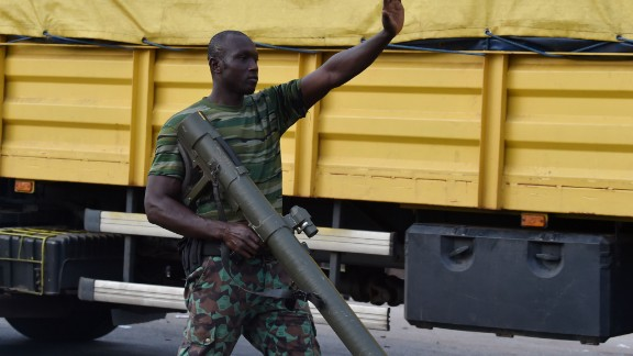 A rebel soldier directs traffic in Bouake. The mutineers took control of the main routes into the city.
