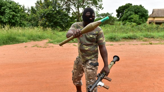 A mutinous soldier holds a RPG rocket launcher inside a military camp in the Ivory Coast