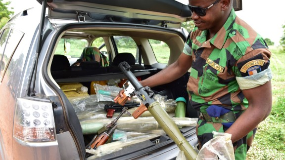 A rebel presents weapons recovered from an inhabitant in Bouake.  The mutineers are from the faction of the army that fought against the former regime led by Laurent Gbagbo in the bloody conflict that followed the 2010 election, which ended with President Alassane Ouattara taking power.   They claim Outtara
