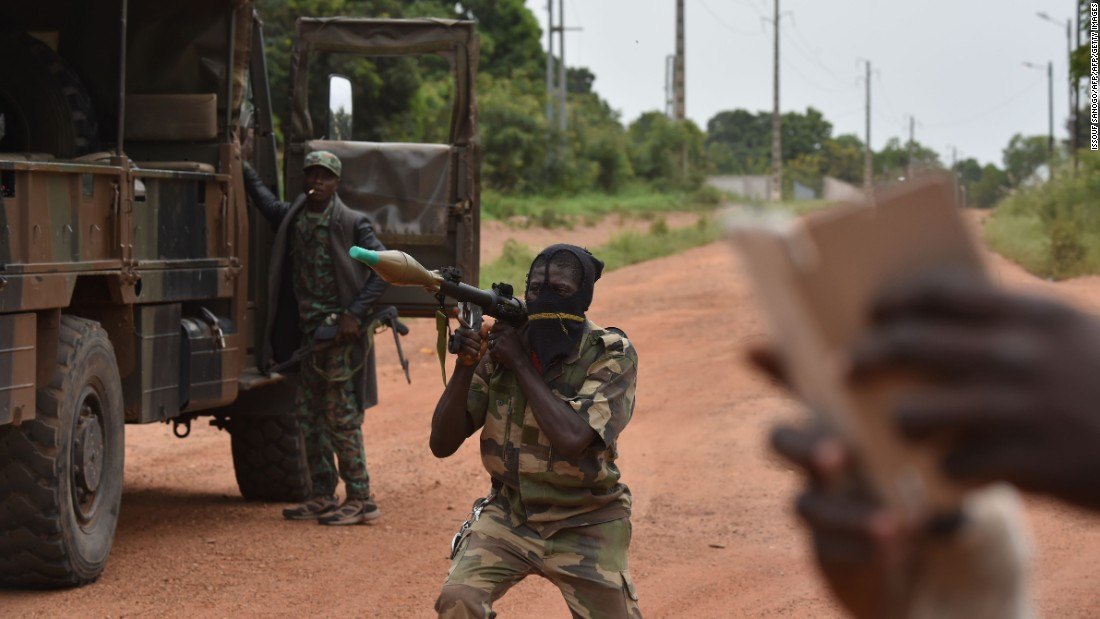 A mutinous soldier holds a RPG rocket launcher inside a military camp in Bouake. <br /><br />This is the rebels' second major uprising in the Ivory Coast this year. The previous dispute ended with a compromise payment. Rebels say they will continue this uprising until they are paid seven million CFA ($11,720).