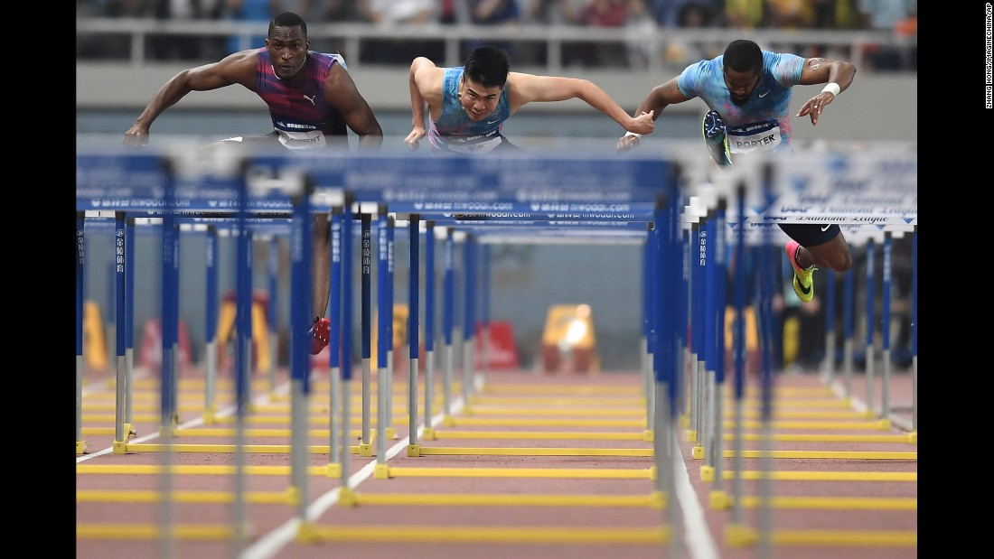 From left, Jamaica's Hansle Parchment, China's Xie Wenjun and the United States' Jeff Porter compete in the 110-meter hurdles at the Diamond League meet in Shanghai, China, on Saturday, May 13.