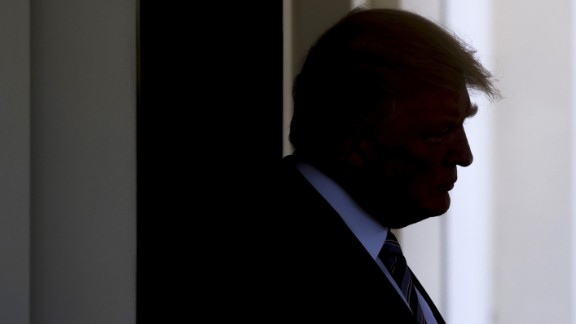 US President Donald Trump pauses Tuesday in the West Wing of the White House.