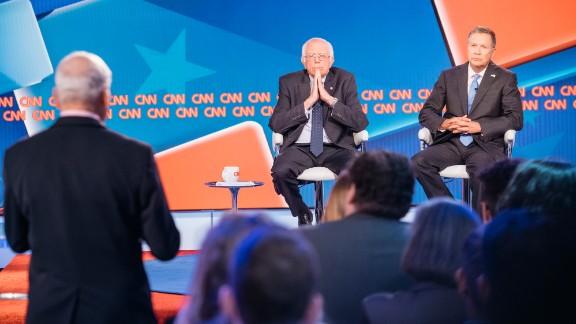 Sen. Bernie Sanders and Ohio Gov. John Kasich speak during a town hall debate on Tuesday, May 16, 2017 in Washington, D.C.