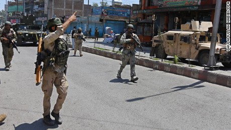 Afghan security officials respond to the attack.