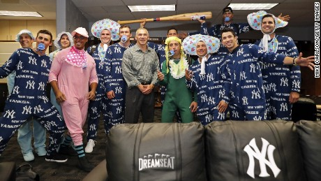 A variation on a theme: The New York Yankees, who are very manly, showing off the recent onesie trend.