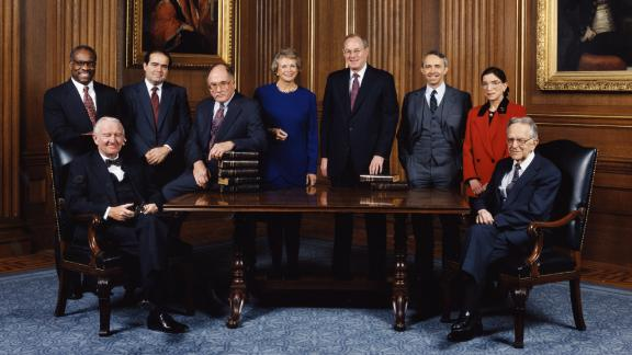 This informal group photo was taken of the US Supreme Court in December 1993. From left are Clarence Thomas, John Paul Stevens, Antonin Scalia, Chief Justice William Rehnquist, Sandra Day O'Connor, Anthony Kennedy, David Souter, Ginsburg and Harry Blackmun.