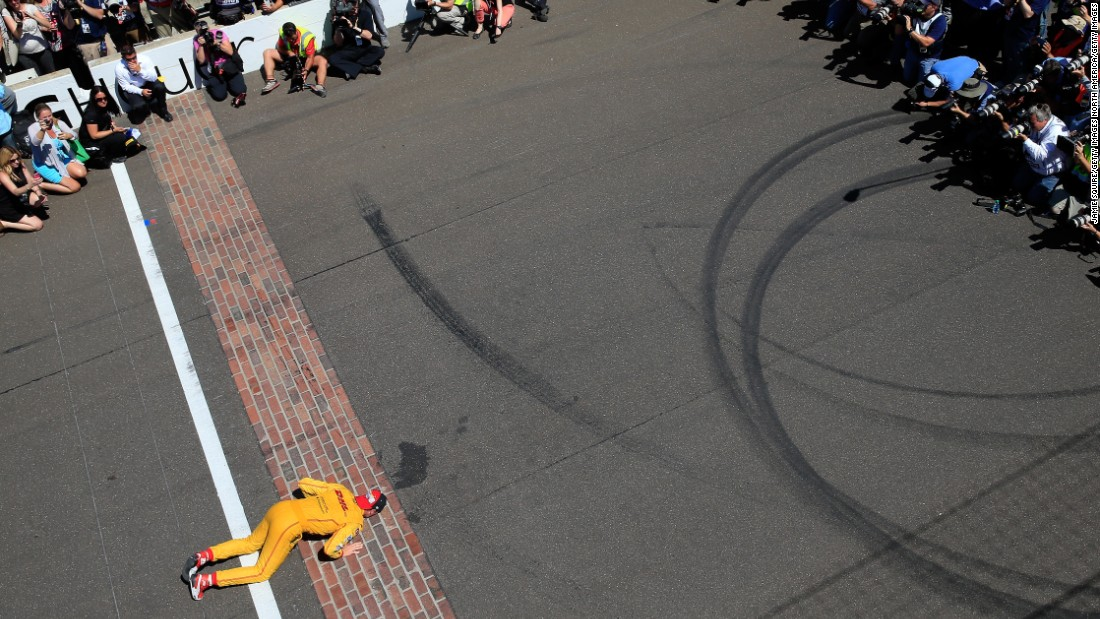 Winners traditionally kiss the bricks on the finish line of track, as seen with 2014 champion Ryan Hunter-Reay.