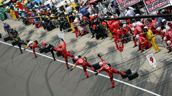 Pit crews direct their drivers at the 2008 Indy 500.