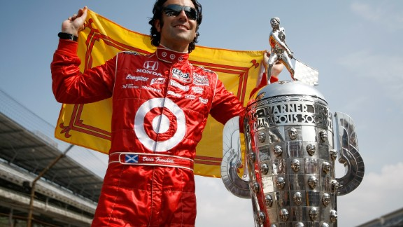 Scottish driver Dario Franchitti, who won the Indy 500 on three occasions, poses with the trophy at the Brickyard in 2010.