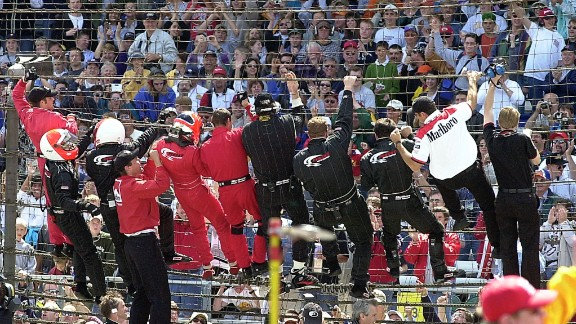 """Driver Helio Castroneves, a three-time Indy 500 winner, climbed the fence with his team after winning in 2001. He made a habit of it throughout his career, and gained the nickname """"Spiderman."""""""