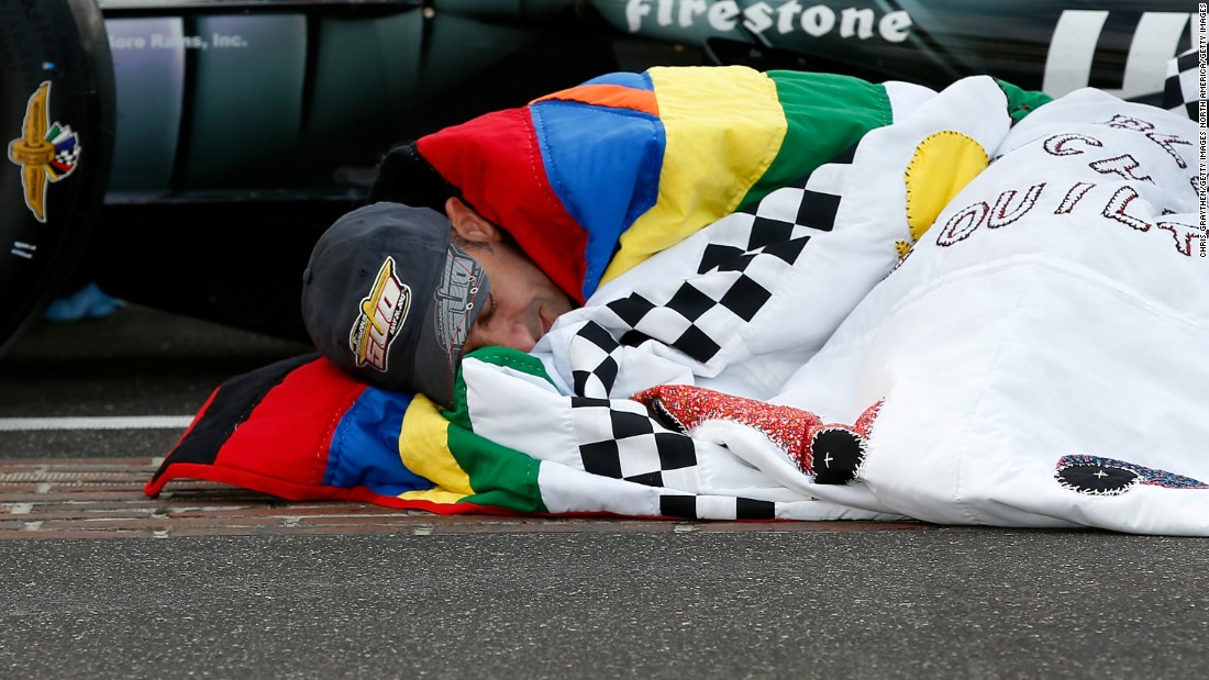 "Since 1976, Jeanetta Holder, a long-time fan of the Indy 500, has produced a custom-made quilt for the winner, earning her the title ""Quilt Lady."" Here, 2013 champion Tony Kanaan snuggles up in his prize blanket."