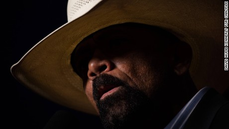 "Milwaukee County Sheriff David Clarke speaks at a Trump rally in Green Bay, Wisconsin, on October 17, 2016. He claimed that the presidential election was rigged and that it was ""pitchfork and torches time in America."""