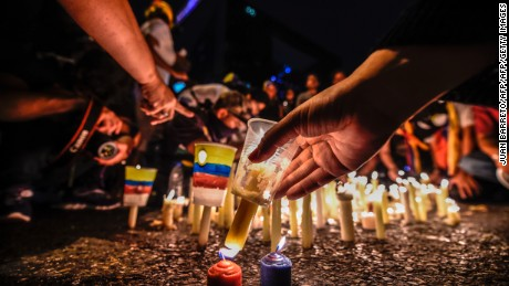 Opposition activists place candles to protest against the deaths of 43 people in clashes with the police during weeks of demonstrations against the government of Venezuelan President Nicolas Maduro, in Caracas on May 17, 2017.  The United States warned on Wednesday at the United Nations that Venezuela's crisis was worsening and could escalate into a major conflict similar to Syria or South Sudan. / AFP PHOTO / JUAN BARRETO        (Photo credit should read JUAN BARRETO/AFP/Getty Images)