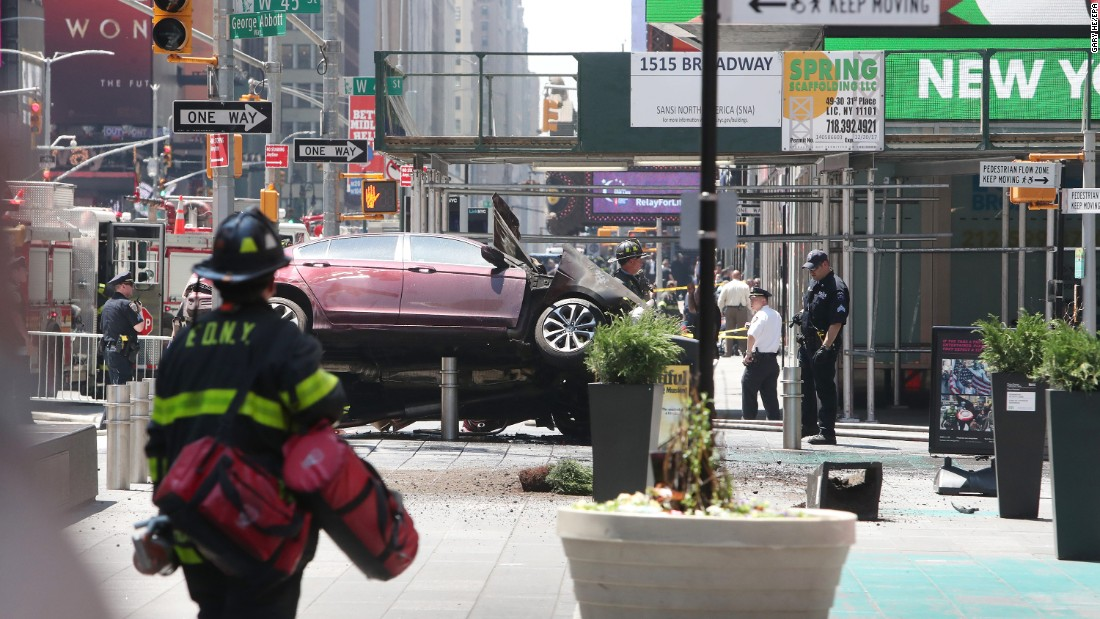 Emergency workers surround the crash site. The motorist, 26-year-old Richard Rojas, has been arrested twice in the past for drunken driving, according to the New York police commissioner.