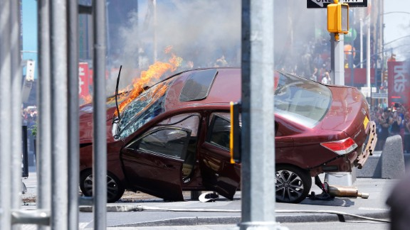 A wrecked vehicle is on fire after hitting pedestrians in New York