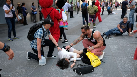 People attend to one of the victims. At least one person was killed and nearly two dozen were injured, officials said.