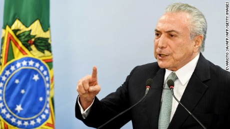 Brazil's President Michel Temer speaks during a press conference following allegations that he gave his blessing to payment of hush money to a politician convicted of corruption, on May 18, 2017 in Brasilia. Temer faced growing pressure to resign Thursday after the Supreme Court gave its green light to the investigation over allegations that he authorized paying hush money to already jailed Eduardo Cunha, the disgraced former speaker of the lower house of Congress.  / AFP PHOTO / EVARISTO SA        (Photo credit should read EVARISTO SA/AFP/Getty Images)
