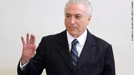 "Brazilian president Michel Temer takes part in the ""A Year of Achievements"" meeting in celebration of the first year of his presidential term, at the Palacio do Planalto in Brasilia, Brazil, on May 12, 2017.   President Michel Temer celebrated one year at Brazil's helm on Friday with some questioning how much has changed in Latin America's biggest country since the traumatic impeachment of Dilma Rousseff. / AFP PHOTO / EVARISTO SA        (Photo credit should read EVARISTO SA/AFP/Getty Images)"
