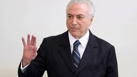 """Brazilian president Michel Temer takes part in the """"A Year of Achievements"""" meeting in celebration of the first year of his presidential term, at the Palacio do Planalto in Brasilia, Brazil, on May 12, 2017.   President Michel Temer celebrated one year at Brazil's helm on Friday with some questioning how much has changed in Latin America's biggest country since the traumatic impeachment of Dilma Rousseff. / AFP PHOTO / EVARISTO SA        (Photo credit should read EVARISTO SA/AFP/Getty Images)"""