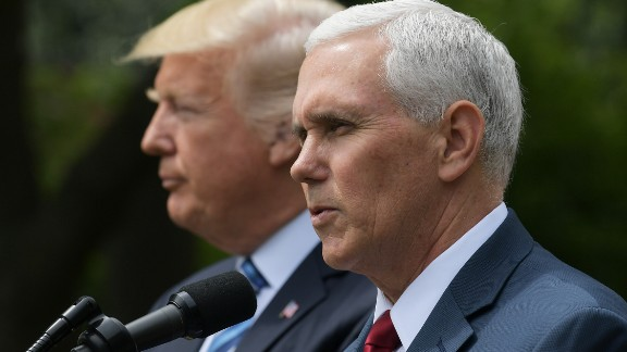 US Vice President Mike Pence (R) speaks while standing next to US President Donald Trump during a ceremony before the signing of an Executive Order on Promoting Free Speech and Religious Liberty in the Rose Garden of the White House on May 4, 2017 in Washington.