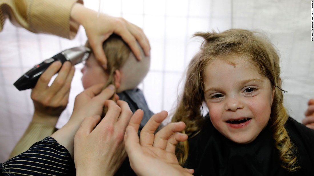 Children in Meron, Israel, take part in a traditional Halake ceremony, getting their first haircuts from their fathers, at the start of the Lag Baomer holiday on Sunday, May 14.