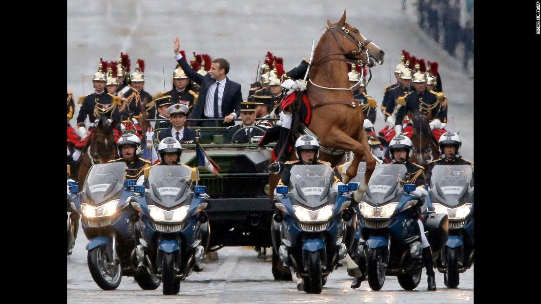 "<a href=""http://www.cnn.com/2017/05/14/europe/emmanuel-macron-france-inauguration/"" target=""_blank"">New French President Emmanuel Macron</a> waves from a military vehicle as he rides toward the Arc de Triomphe in Paris on Sunday, May 14."