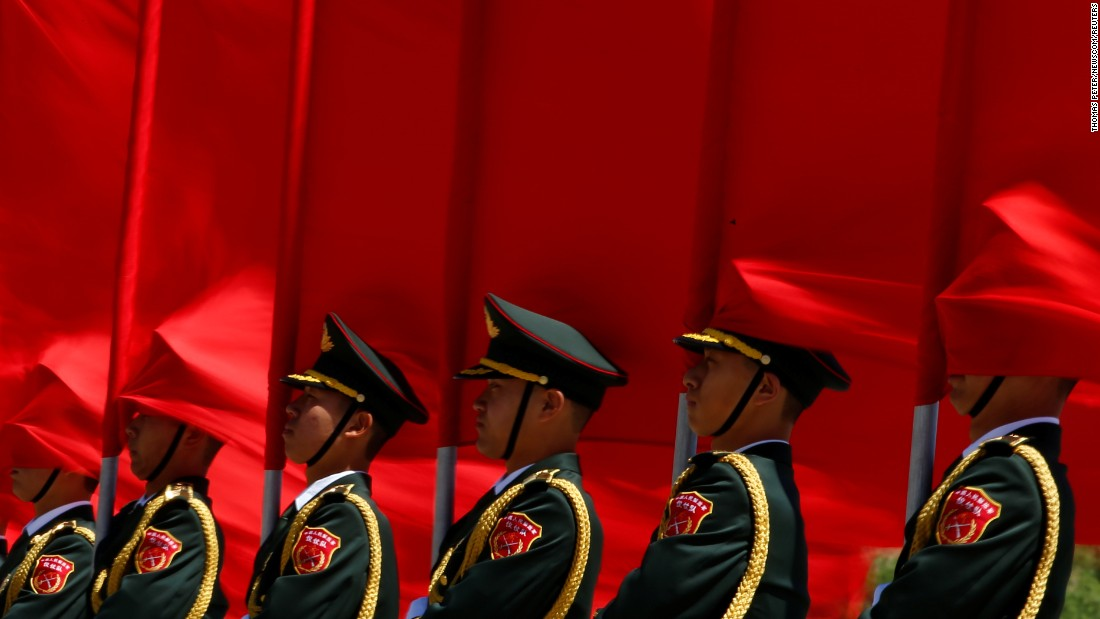Honor guards stand in Beijing before a welcoming ceremony for Chinese Premier Li Keqiang and Hungarian Prime Minister Viktor Orban on Saturday, May 13.